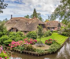 Ancient cottages in Giethoorn by the canal